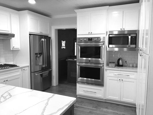 Athens custom kitchen remodel with granite counters and kitchen cabinetry.