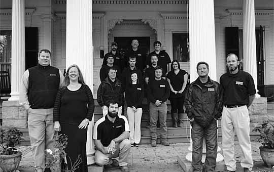 Savannah construction company team standing beside local historic preservation architecture.
