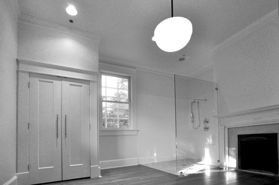 Residential master bath remodel in historic home includes glass shower and fireplace restoration.